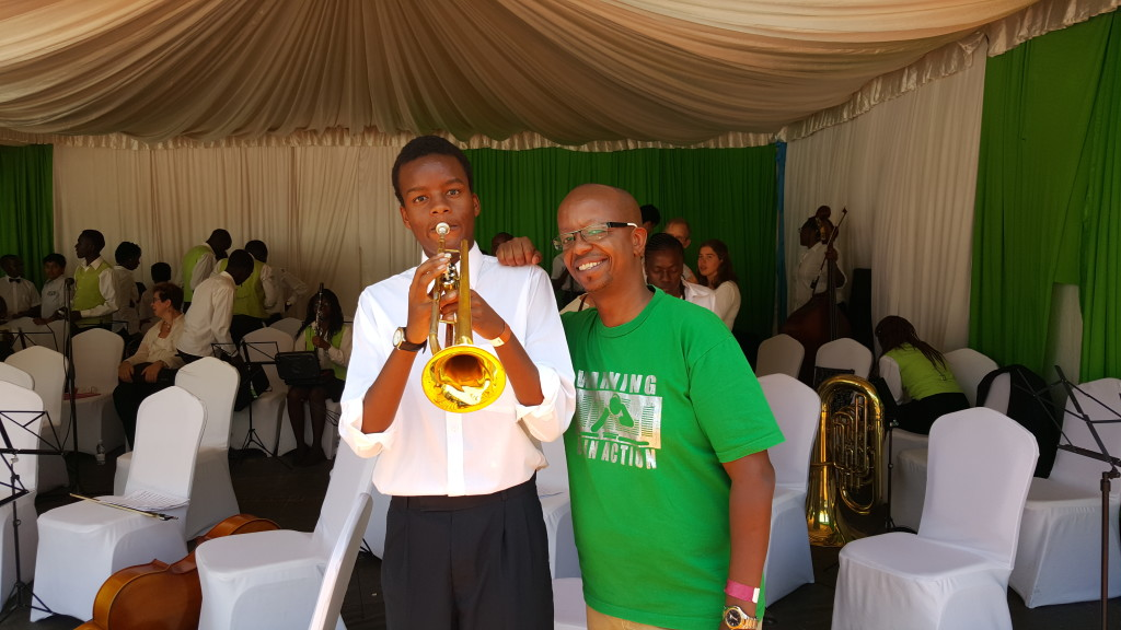 Dj D-lite with his son, his son is a member of the Safaricom Youth Orchestra