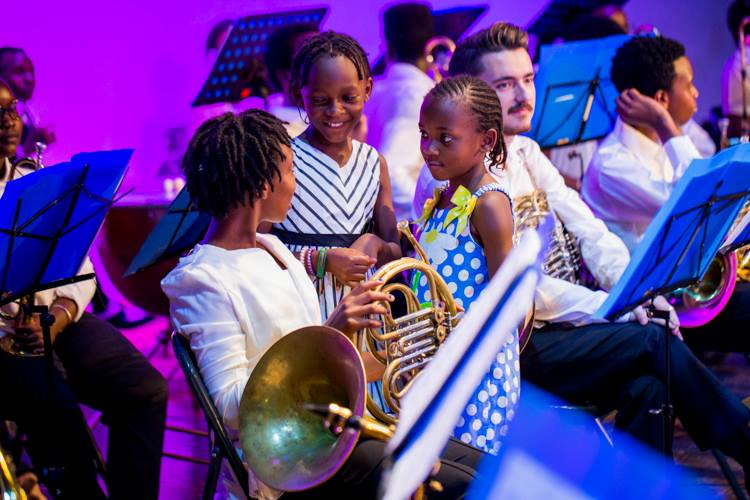 Children aged below 10 years enjoying their time with orchestra members