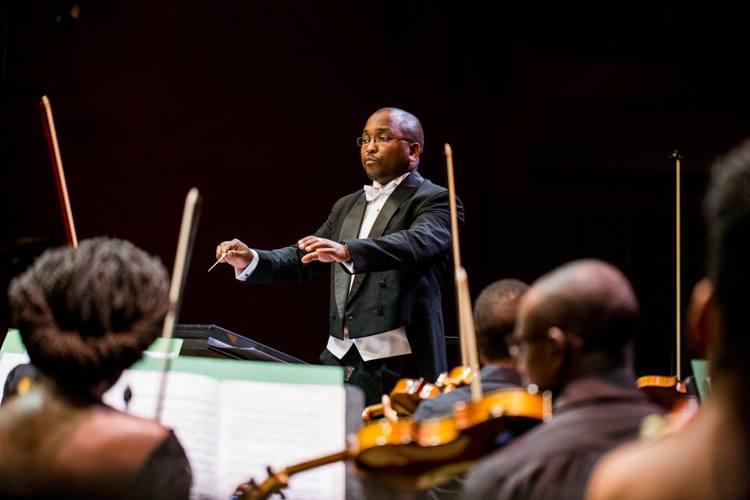 Duncan Wambugu conducting members of Nairobi Orchesttra