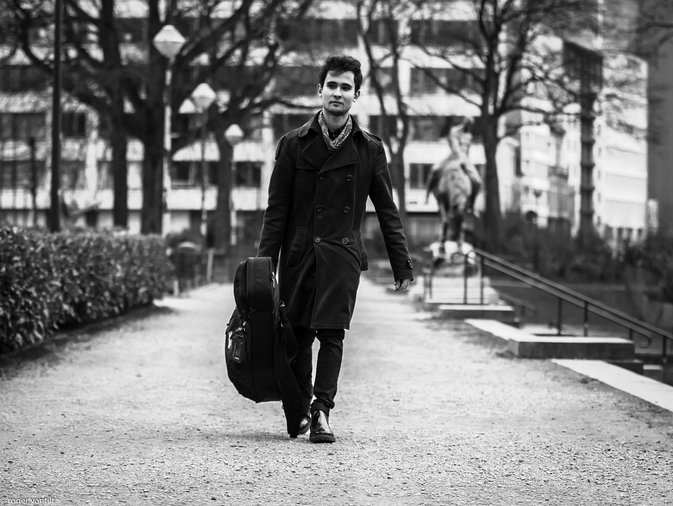 Matteo with a Guitar walking in