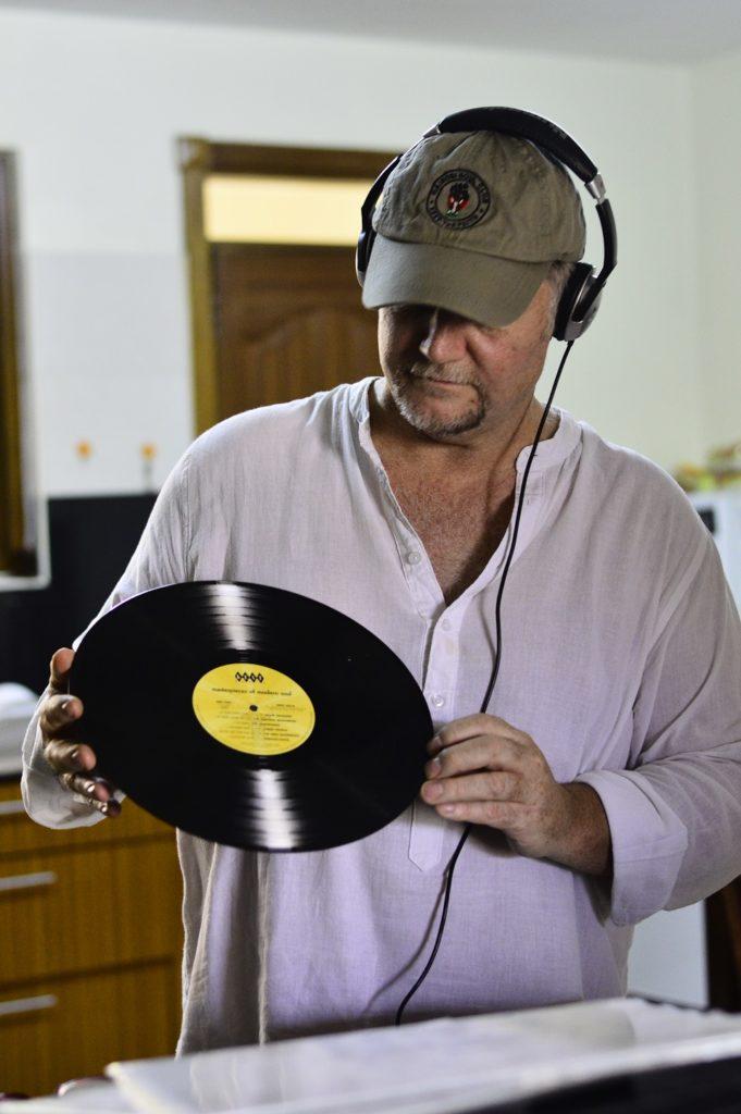 Jimmy Greene Admiring his records