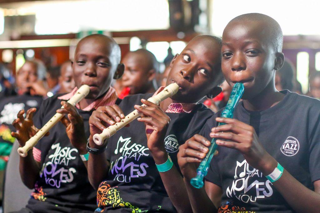 Three Ghetto Classics children playing recorder